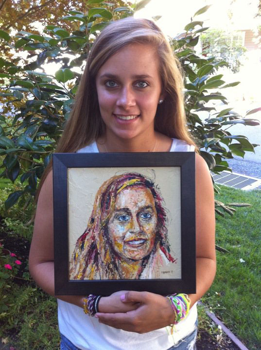 Hannah in California with her painting.